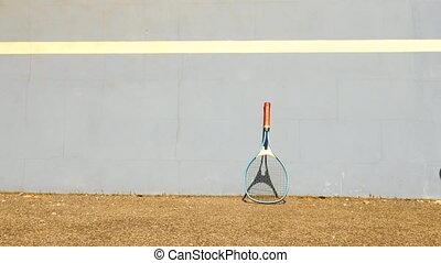 Bouncing Tennis Ball against Wall. Tennis ball jumping on...
