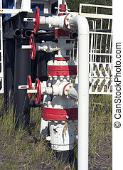 bound white fuel pipes with the red gates, making industrial system