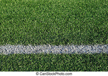 boundary line on an artificial turf athletic field
