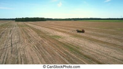 boundless expanses of cleaned fields and motorized sprinkler...