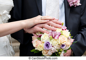Bouquet and hands with rings
