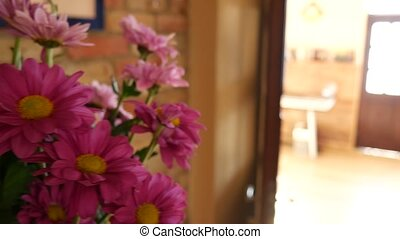 Bouquet Astra in a vase in the room