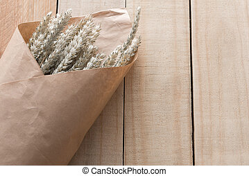 bouquet dry grass on wooden