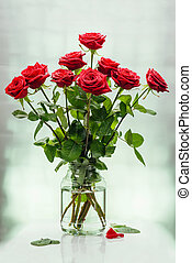 Bouquet from scarlet magnificent roses in bank with water on...