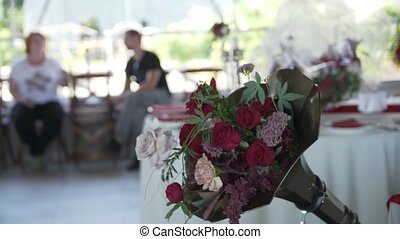 bouquet in the gramophone trumpet on a blurred background of the banquet hall