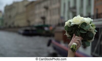 Bouquet in womans hand ship on background