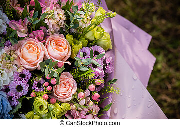 bouquet made of Alstroemeria, Gerber, Rose and Chrysanthemum flowers isolated on green. Composition of roses and chrysanthemums. Celebration, floral present. Copy space