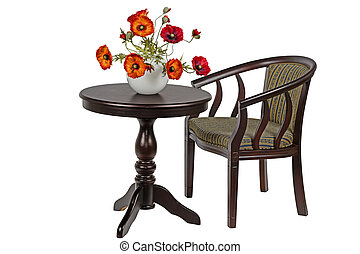 Bouquet of artificial poppies in a vase on the round table, isolated on white background