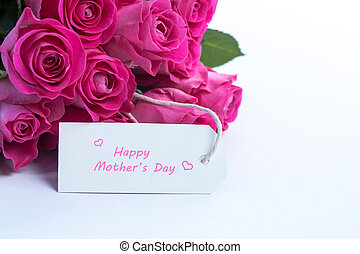 Bouquet of Beautiful pink roses with happy mothers day card on a white table