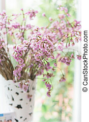 Bouquet of beautiful spring flowers of lilac in a vase