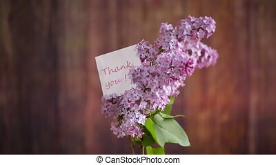 bouquet of beautiful spring flowers of lilac on the table