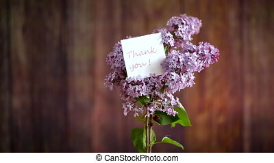 bouquet of beautiful spring lilac flowers on a wooden background