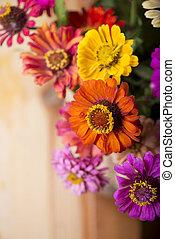 bouquet of beautiful wild flowers in a wattled basket