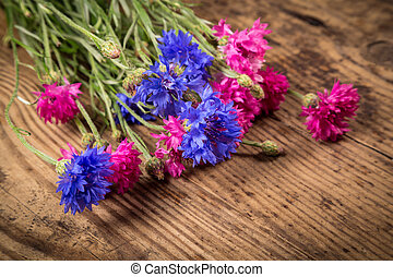cornflowers on wooden background