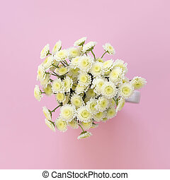 Bouquet of chrysanthemums on a pink background.