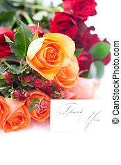 bouquet of colorful roses and a card with the words thank you