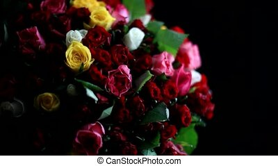 Bouquet of colorful roses in a variety of colours on black background. 1920x1080