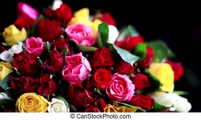 Bouquet of colorful roses in a variety of colours on black...