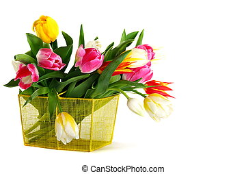 Bouquet of colorful tulips in a yellow basket.