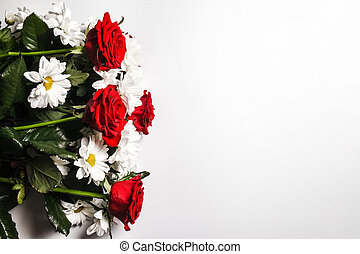 Bouquet of daisies and roses on a white background