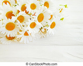 bouquet of daisies on a wooden