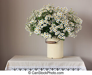 Bouquet of daisies on the table.