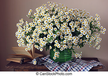 bouquet of daisies on the table. flowers in a vase.