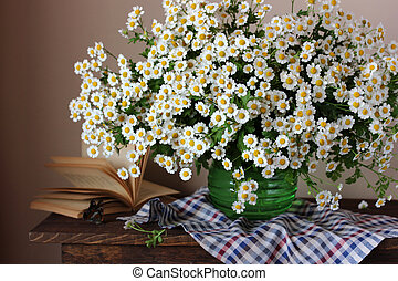 Bouquet of daisies. Still life with flowers in a vase.