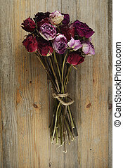 bouquet of dried roses on a wooden background