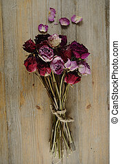 bouquet of dried roses on a wooden