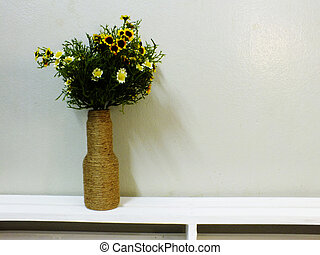 bouquet of flower in vase on wooden blackground