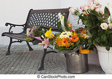 Bouquet of flowers and the bench