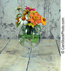 bouquet of flowers in a cup