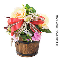 Bouquet of flowers in wood bucket isolated on white