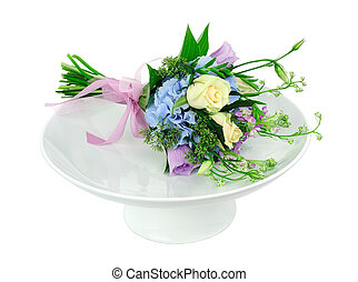 Bouquet of flowers on a white dish
