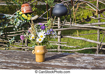 Bouquet of flowers on rustic table