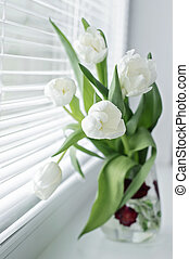 bouquet of flowers on the window sill