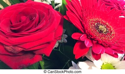 Bouquet of Flowers with red roses, daisies and gerberas. -...