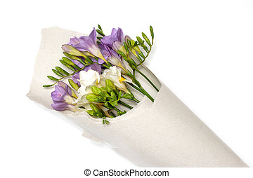 bouquet of freesia in the paper
