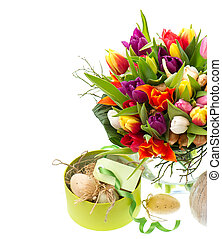 bouquet of fresh multicolored tulips with easter eggs