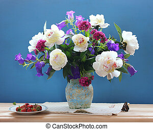 bouquet of garden flowers, butterfly and strawberry on blue background.