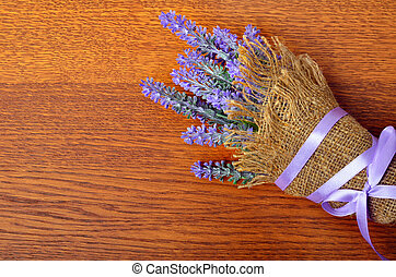 Bouquet of lavender in sack .