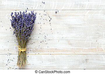 bouquet of lavender on a wooden table top view