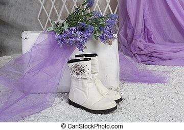 bouquet of lavender rests on an old suitcase in a bright room