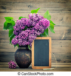 bouquet of lilac flowers. blackboard for your text