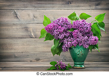 bouquet of lilac flowers in vase