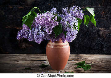 lilac in a vase of different colors