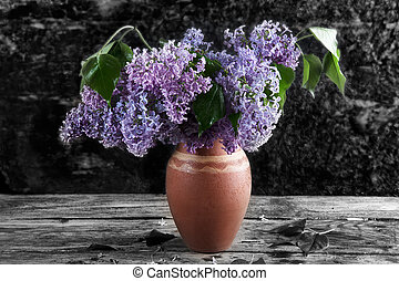 bouquet of lilac in a vase on the background