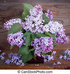 Bouquet of lilac on old boards background darkness variant