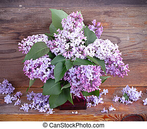 Bouquet of lilac on old boards background